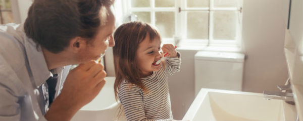 cavity development in father and daughter brushing teeth